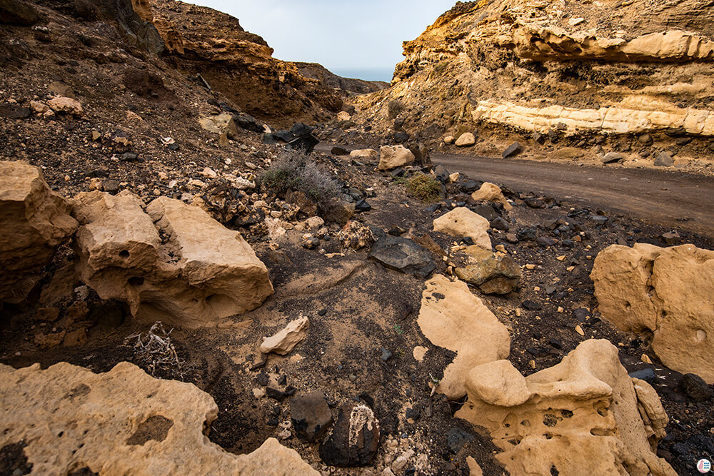Path to Roque Del Moro through a small canyon, with interesting sandstone formations, Fuerteventura
