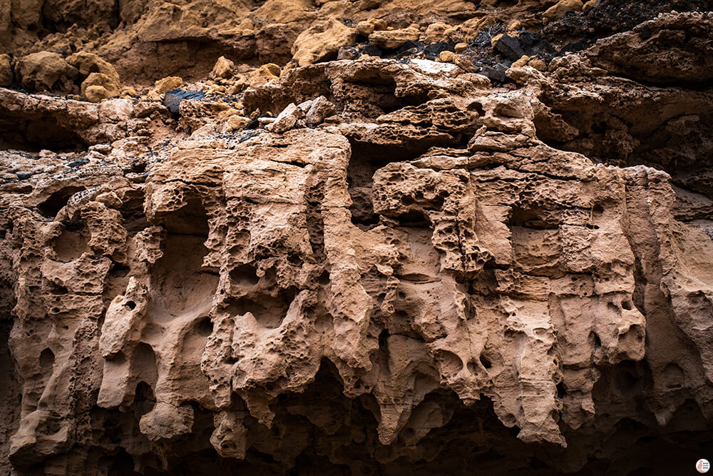 Eroded sandstone on the path leading to Roque Del Moro, Fuerteventura