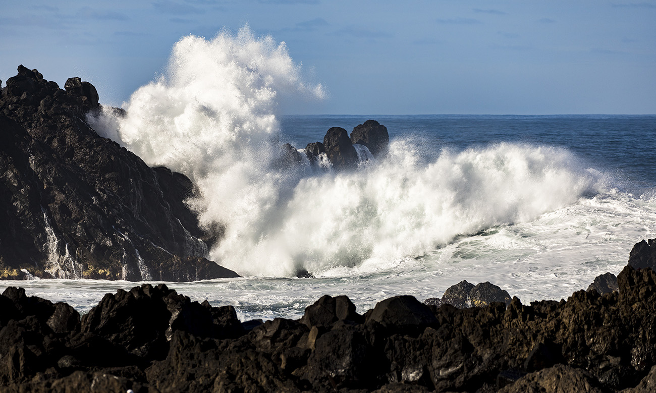 Wave smashing into rocks in Seixal, Madeira