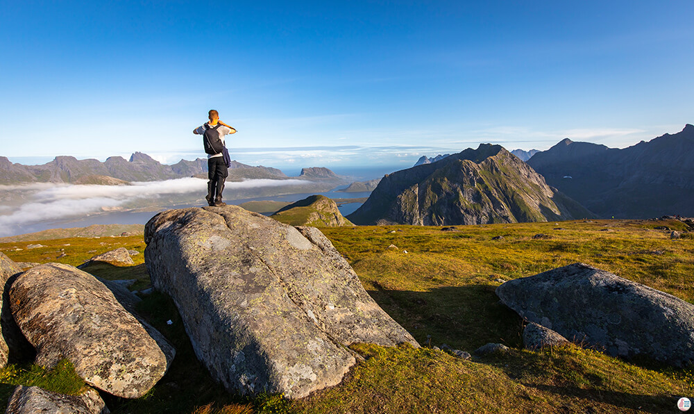 Tourist taking picture at Ryten, Moskenesøya, Lofoten, Norway