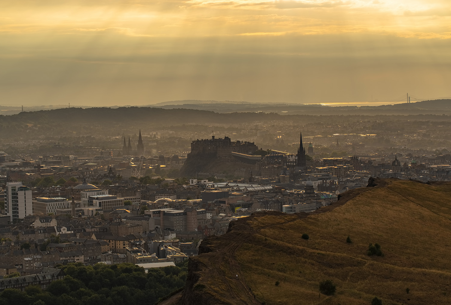 Rays of sunshine over Edinburgh from Arthur's Seat