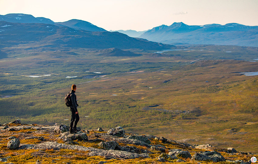 Man admiring the view on Saana hiking trail, Kilpisjärvi, Lapland, Finland