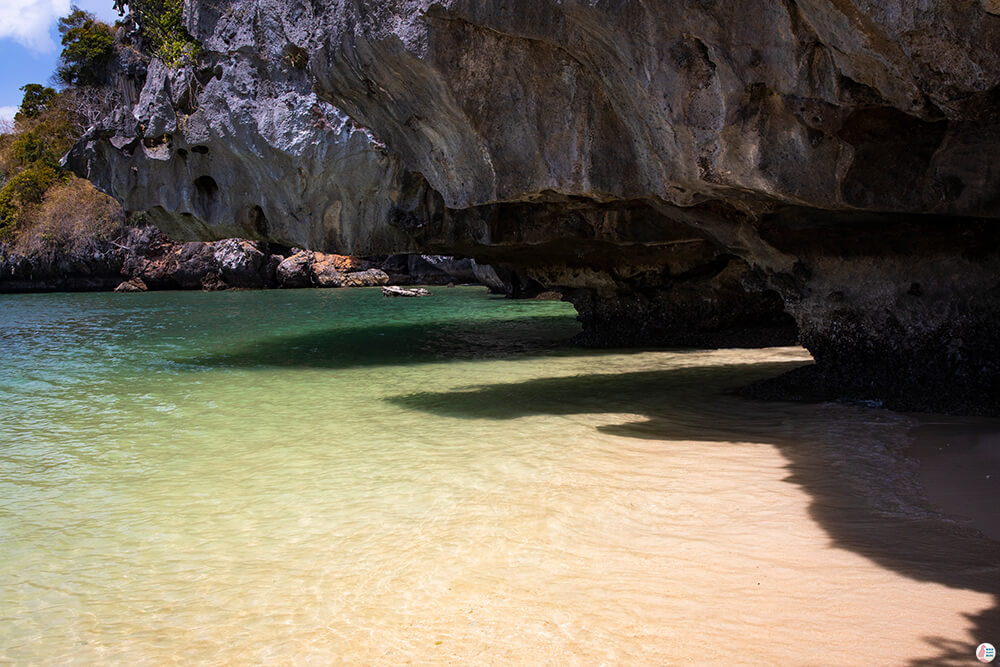 Big cliff with crystal clear water at West Phra Nang Beach, Railay Bay, Krabi, Thailand